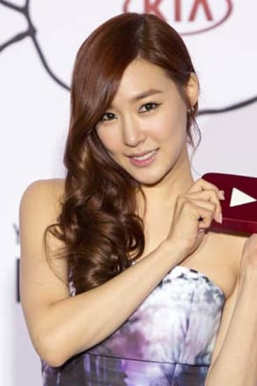 Winner: Tiffany of the musical group Girls' Generation speaks after accepting the Video of the Year award.