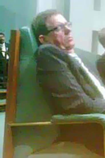 The camera-phone image of a sleeping Peter Slipper.