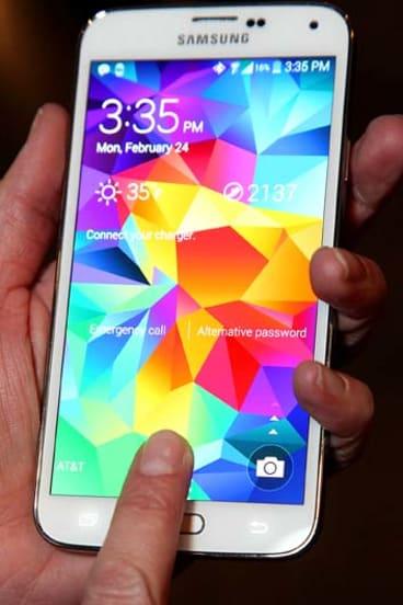 Using the Galaxy S5's fingerprint scanner.