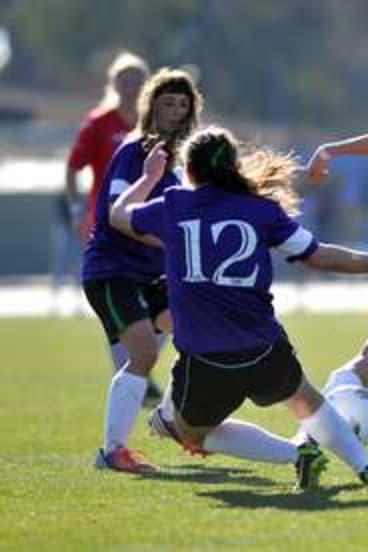 Emily Spiteri, left, and Kate Thornton in action in the Under-19 female Cup final.