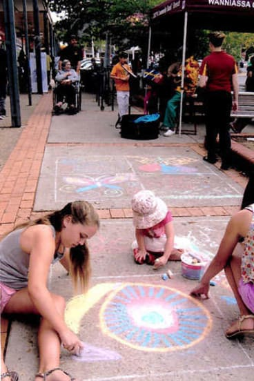 Family time: Chalk drawing at the Parties at the Shops event at Wanniassa.