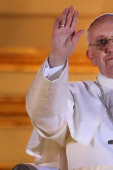 Newly elected Pope Francis I waves to the waiting crowd from the central balcony of St Peter's Basilica.