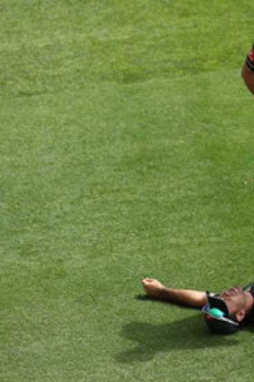 Ricky Ponting gets worked on during Australia's net session at the Gabba yesterday.