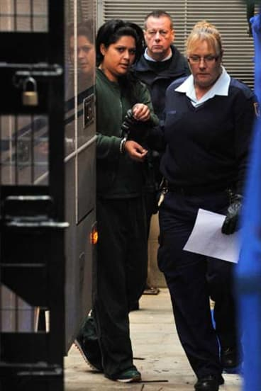 ''I will kill her'': Kristi Anne Abrahams is led into court.
