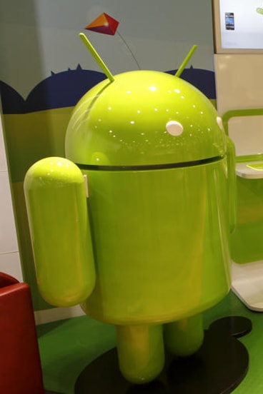 One of Androidland's giant green alien mascots.