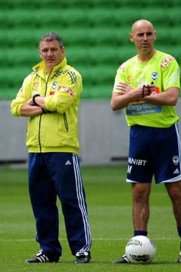 Tough times: Mehmet Durakovic and Kevin Muscat at Melbourne Victory training.