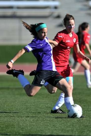 Monaro Panthers' Julia Bedin strikes the ball as Alicia Tupper tries to intercept.