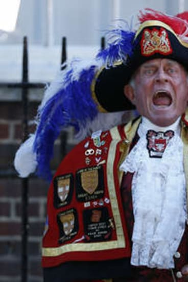 Tony Appleton, a town crier,  announces the birth of the royal baby, outside St. Mary's Hospital on July 22.