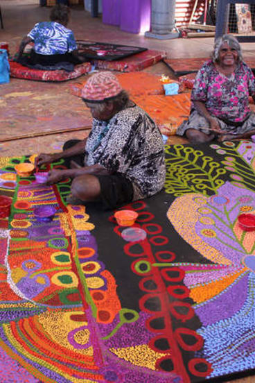 Traditional artists Wawiriya Burton (left) and Ruby Williamson. Artworks from South Australia's Tjala Arts range from traditional styles done in modern colours to more contemporary experimentations.