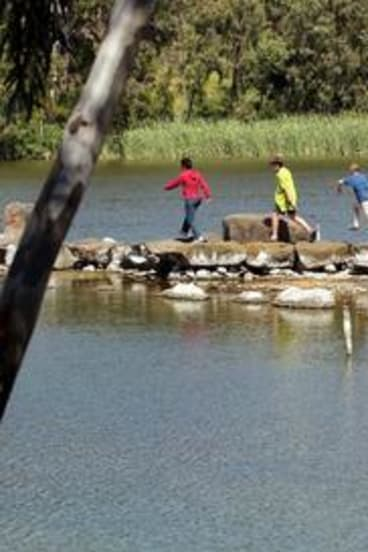 Children play at Newport lakes.