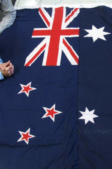 The flags of New Zealand (left) and Australia.