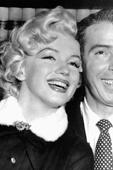 Marilyn Monroe with second husband baseball star Joe DiMaggio on their wedding day: January, 14, 1953.
