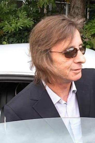 AC/DC drummer Phil Rudd has been questioned by police.