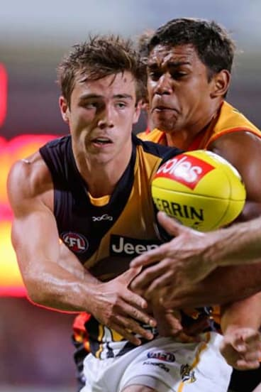 Steven Verrier of the Tigers is tackled during the exhibition match between the Richmond Tigers and the Indigenous All-Stars at Traeger Park in Alice Springs earlier this year. The game was not televised.
