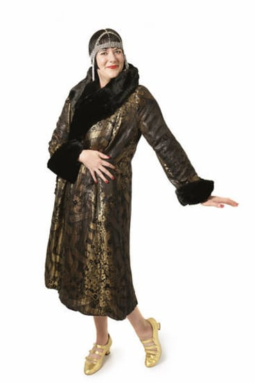 All that jazz … author and 1920s vintage-clothing collector Inger Sheil, wearing a 1920s gold lamé coat and headdress and reproduction shoes.