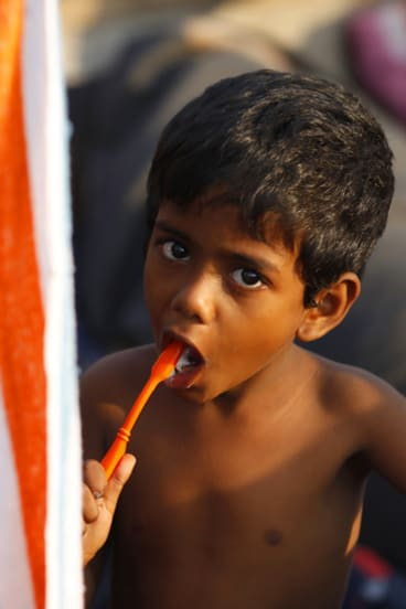 A Sri Lankan asylum seeker brushes his teeth on a boat at the Cilegon harbour in Indonesia's Banten province.