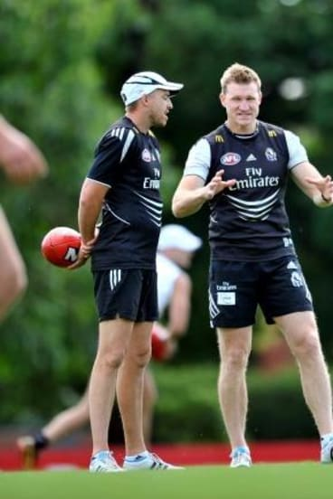 Lappin, left with coach Nathan Buckley, had responsibility for the Magpie forwards.