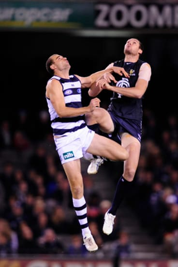 Geelong's Trent West, left, pictured battling with Carlton's Robert Warnock, will miss the clash against Hawthorn.