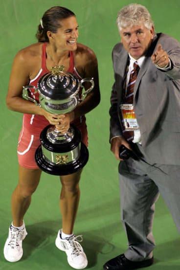 Paul McNamee with Amelie Mauresmo after winning the 2006 Australian Open.