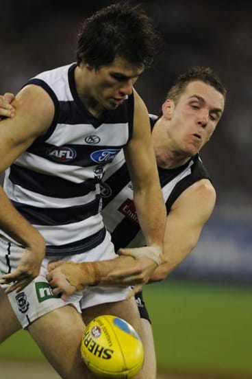 Not much between them. Geelong's Andrew Mackie battles with Collingwood's Dane Swan.