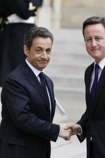 French President Nicolas Sarkozy greets British Prime Minister David Cameron before a crisis summit on Libya earlier this year.