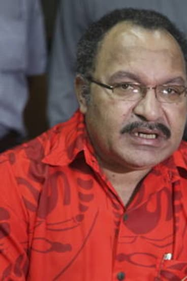 Peter O'Neill at a press conference in Port Moresby.