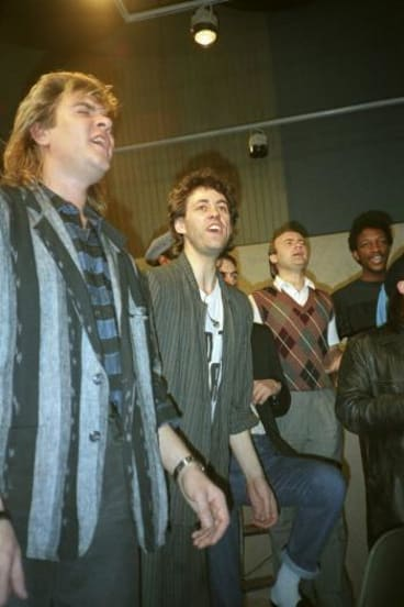 SIng yer heart out: Simon LeBon, Bob Geldof and Phil Collins recording <i