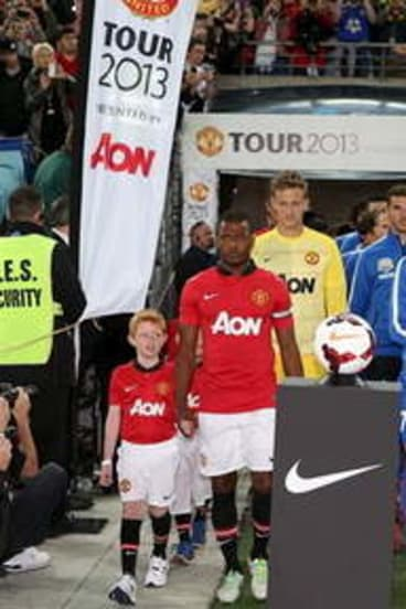 Daniel Findlay, left, walks out with Manchester United star Patrice Evra last weekend.