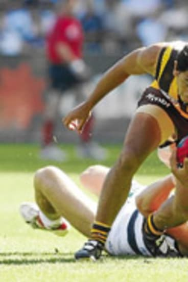 Cyril Rioli breaks a tackle in the 2008 grand final.