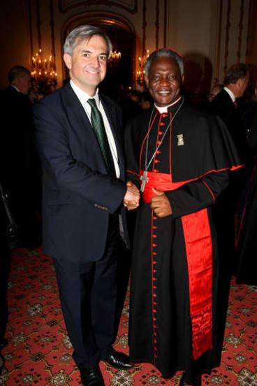 Early favourite ... Ghana's Cardinal Turkson, right.