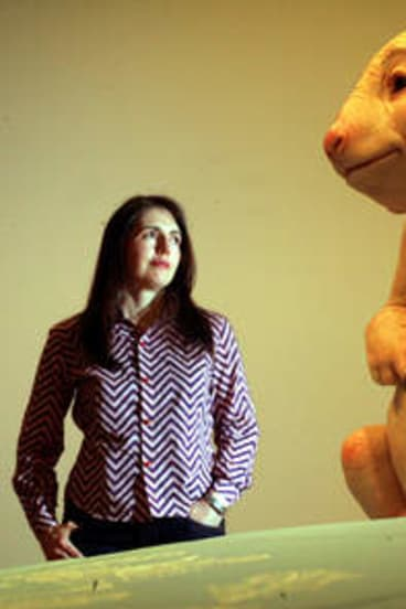Narrabundah College graduate and artist Patricia Puccinini with her work <i>Surrogate</i>.