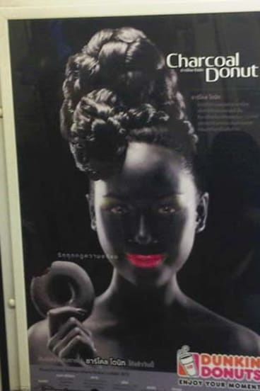 """Offensive: A leading human rights group has called on Dunkin' Donuts to withdraw the """"bizarre and racist"""" advertisement for chocolate doughnuts in Thailand."""