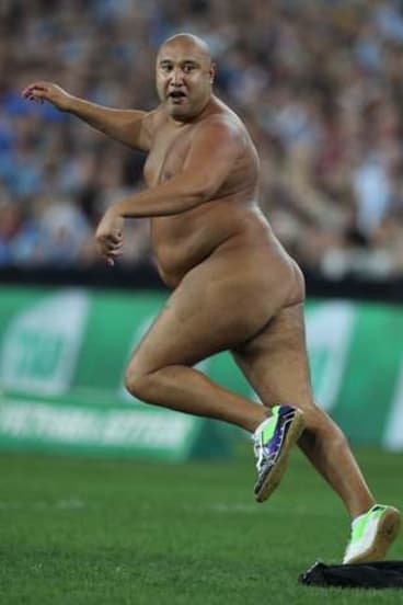 Spring in his step: a streaker runs onto the field.