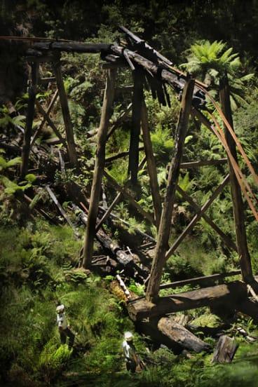 Tram tracks dangle from the ruins of the Beech Creek trestle bridge.