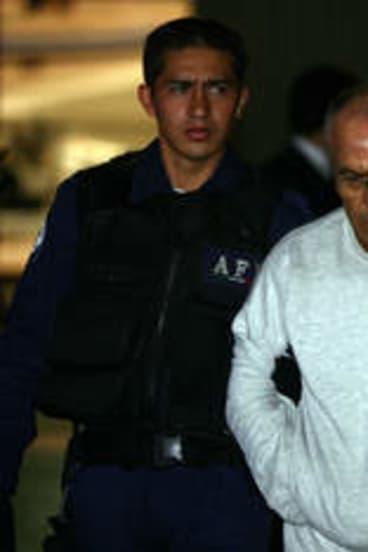 Jean Succar Kuri under police guard in Mexico City in 2006.