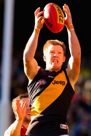 Jack Riewoldt of the Tigers takes a mark during the  match between the Melbourne Demons and Richmond at the MCG.
