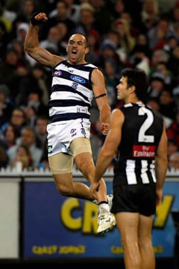 Redemption ... Geelong's James Podsiadly, left, celebrates.
