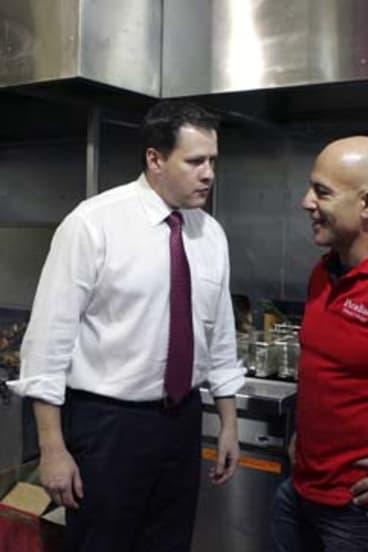 Ed Husic, left, speaks with local business owner Simon Munzar at Mount Druitt.