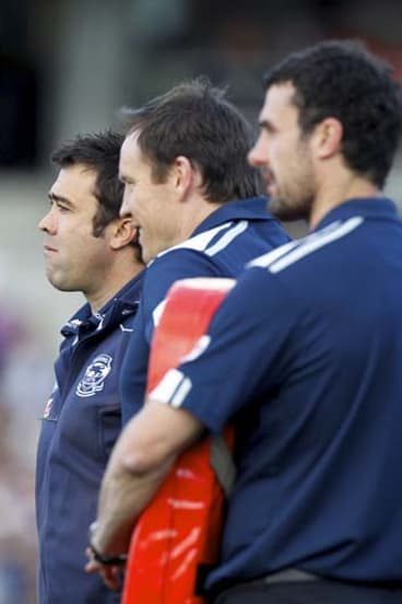 Cats senior coach Chris Scott (left) with assistants Brenton Sanderson and Nigel Lappin, 27 August 2011.