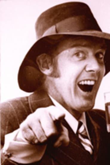 Australian entertainer Barry Crocker as Bazza McKenzie with glass of beer.