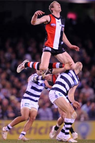 St Kilda's Ben McEvoy rides Geelong's Trent West at the centre bounce.