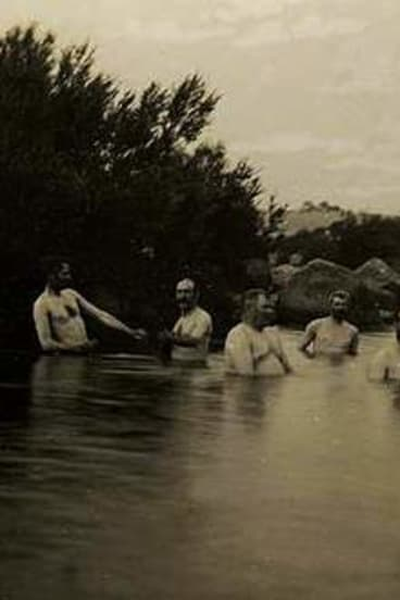 Photo by E.T Luke of Senators bathing in the Snowy River at Dalgety.