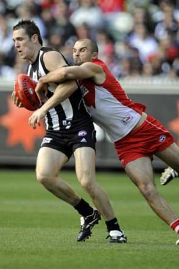Sydney's Rhyce Shaw tackles former teammate Dane Swan, of Collingwood, in a game in 2009.