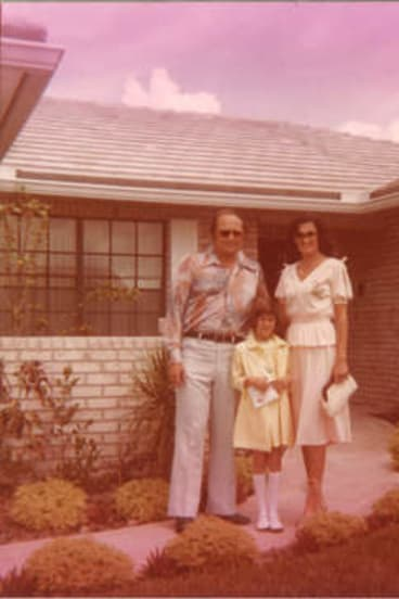 Living in the '70s: Kristin Battista-Frazee with her father Anthony and mother Frances.