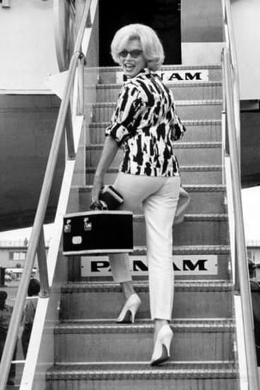 Marilyn Monroe boards a Pan Am flight Miami International Airport in 1962, the year she died.