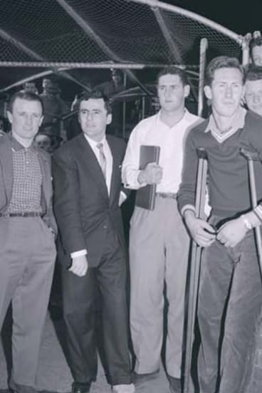 Injured Magpies at the 1960 VFL grand final. Thorold second from left with Bill Serong and Brian Dorman. Jockey Geoff Lane at left.
