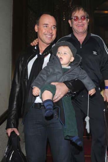 Happy family ... David Furnish and Elton John with their son Zachary.
