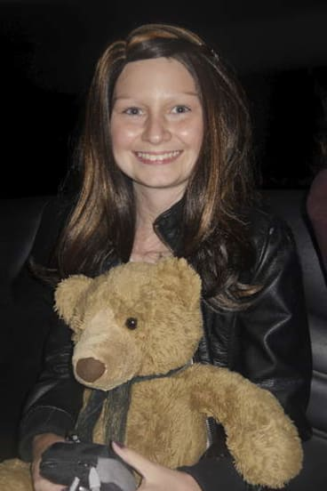 Gungahlin teenager Dainere Anthoney with her teddy bear Theodore.