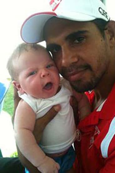 """""""He didn't cry when I first held him, but I had a few tears"""" ... Lewis Jetta, with son Lewis."""