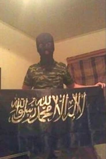 18-year-old shooting victim and terror suspect Numan Haider poses with a jihad flag.